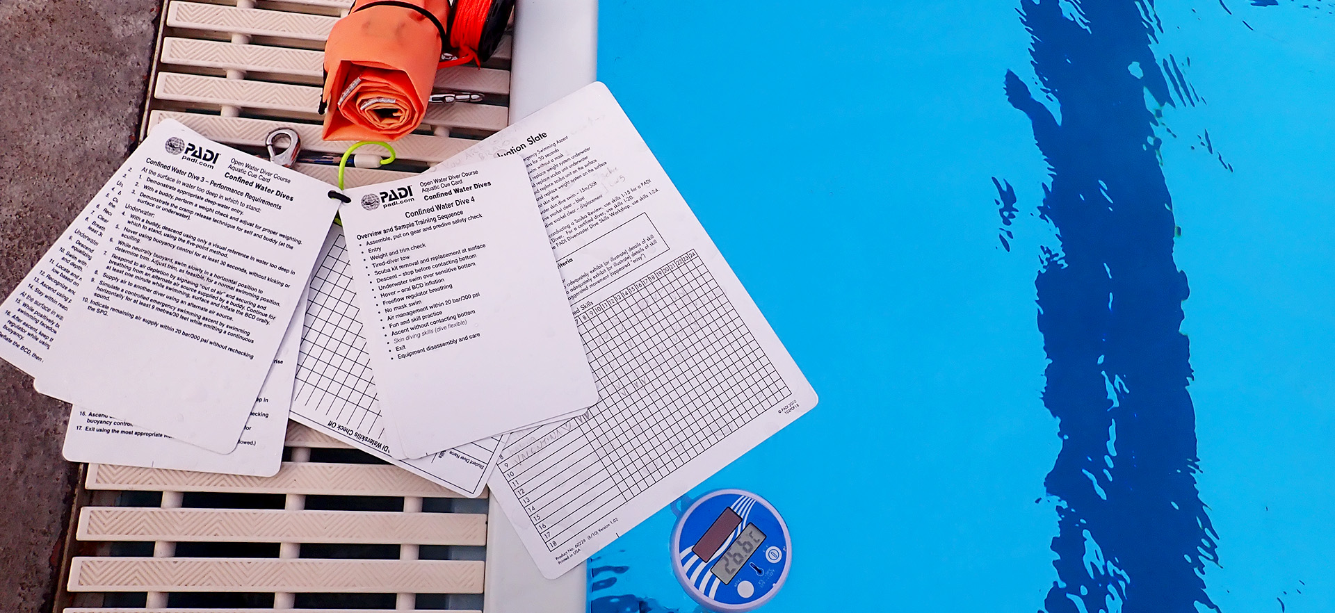 Diving documents next to swimming pool